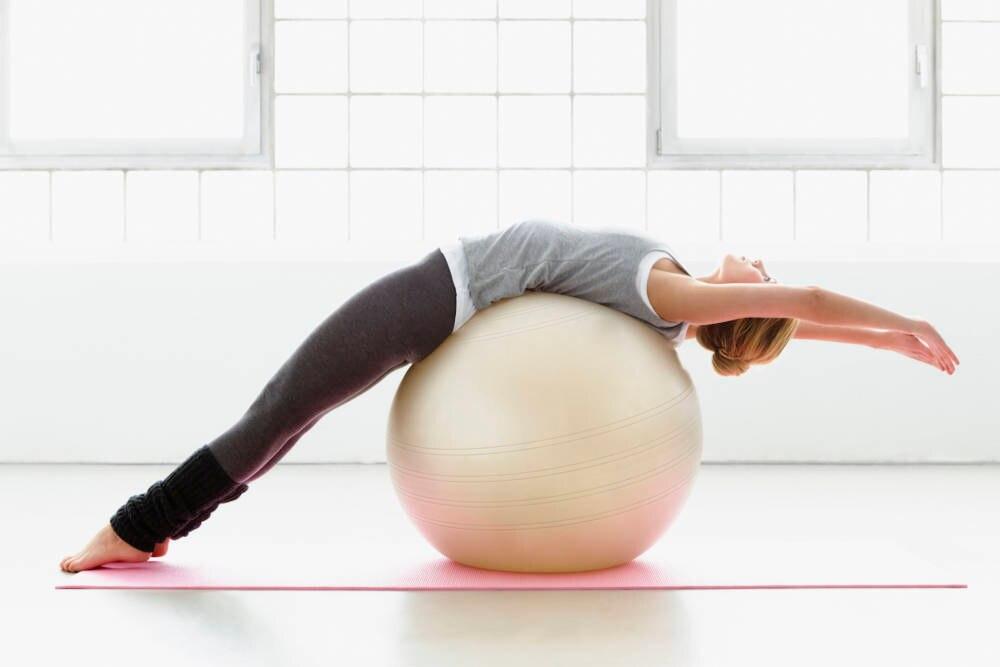 Frau bei der Gymtastik