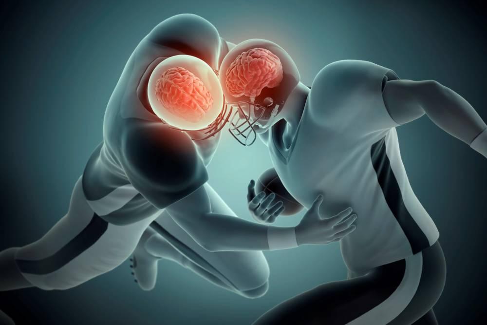 Zwei Football-Spieler stoßen mit dem Kopf zusammen